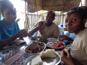 Everlyne Kitavi, Christine Mwendwa and Charles Mwendwa enjoying local cuisine at Mutito village on the foothills of Mutito Hills - Kitui county - pic copyright Rupi Mangat