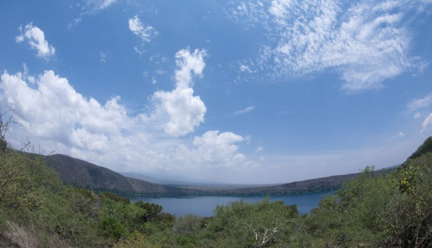 Lake Chala - a crater lake on slopes of Kilimanjaro - with the Kenya-Tanzania border running through the middle. Copyright Luca Borghesio