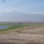 Ice-capped Mount Kilimanjaro, the swamps of Amboseli and its desert plains - an amazing tapestry. Copyright Rupi Mangat