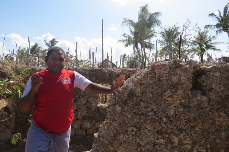 Bwanamkuu Mohamed Hamdu at the grave of the seven virgins who asked God to divine and committed suicide rather than be defiled when the Portuguese invaded the island about seven centuries agoon Pate island Copyright Maya Mangat