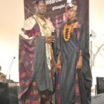"""At the launch of Google's Art & Culture, a world wide event, models wear the African Heritage Collection at African Heritage House. Rosemary shows """"Adinkira"""" cloth hand printed with calabash stamps by the Ashanti in Ghana. Male model wears an """"Agbada"""" hand woven on narrow strip looms by Yoruba men in Nigeria."""