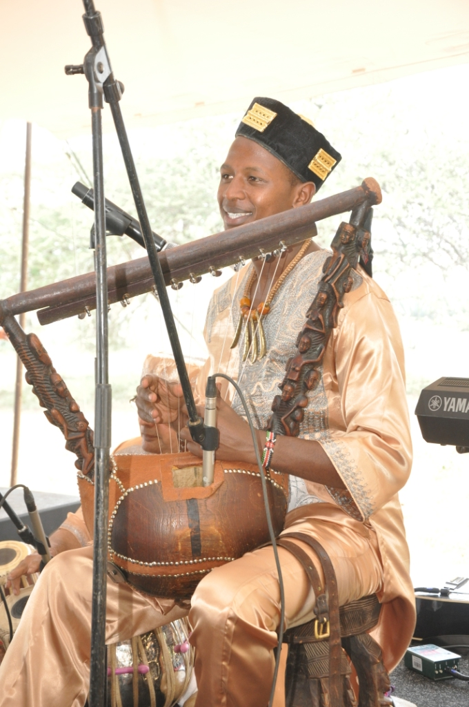 """Papillon starred at the Google event at African Heritage House playing an assortment of hand made musical instruments based on instruments thousands of years old. He wears a velvet cap studded with """"fetish gold"""" from the Baoule of Ivory Coast."""