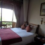 Beautiful room at Paraa Safari Lodge by the Nile in Murchison Falls National Park - notice the picture above - it's of Ripon Falls at Jinja - the source of the Nile - now submerged becuase of the dam downstream Copyright Rupi Mangat