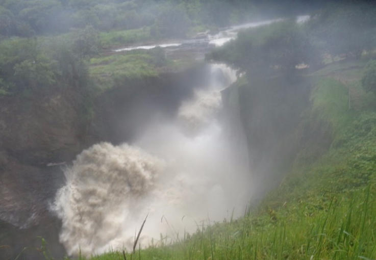 Murchison Falls - from the top. The Bakers' chanced upon it in 1864 coming back from Lake Albert (again they were the first European explorers to see it). Their boat was raised out of the water by a hippo and they had to jump on shore! Copyright: Rupi Mangat