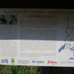 Almost hidden sign by Karuma Falls telling the story of the Bakers' sighting of the rapids in 1864 Copyright Rupi Mangat