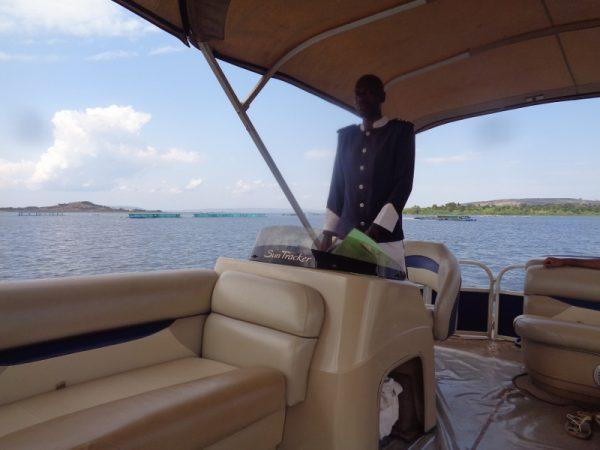 Captain Masanja of Jinja Sailing Club sailing us down the Nile from the mighty Victoria at Jinja, Copyright Rupi Mangat