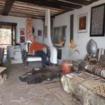 Alan Donovan seated at African Heritage House with his collection of African arts. Copyright Rupi Mangat