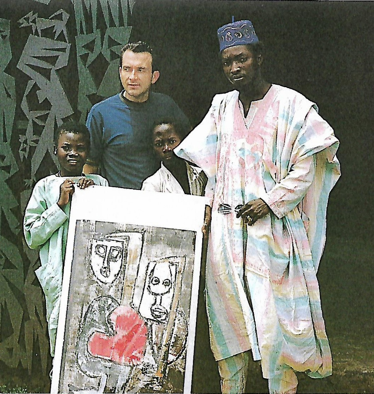 Alan Donovan buying his first work of African contemporary art from Nigerian artist Muraina Oyelami in Oshogbo Nigeria, in 1967. The Oshogbo group of artists celebrate their 50th anniversary this year with Alan Donovan who arrived in Africa in 1967, during a mammoth city wide Nigerian Festrival in Nairobi during the months of October and November.