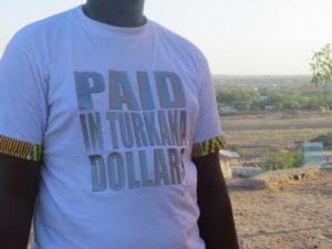 Turkana man on Loima Hill in Lodwar wearing T-shirt Paid in Turkana dollars Copyright Rupi Mangat