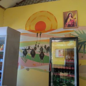 Saint Teresa's Pastoral Centre on the banks of the Turkwel - mural painted by the Hawa artists in 2004 in Lodwar from paints made of natural desert sands on site. Copyright Rupi Mangat