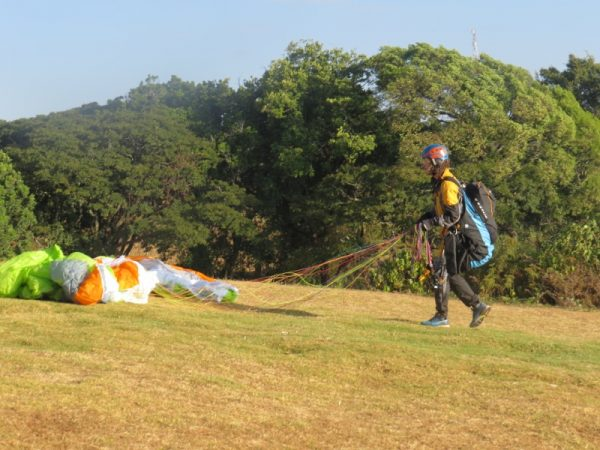 Paraglider on Elgeyo Marakwet escarpment getting ready to take off. Copyright Rupi Mangat