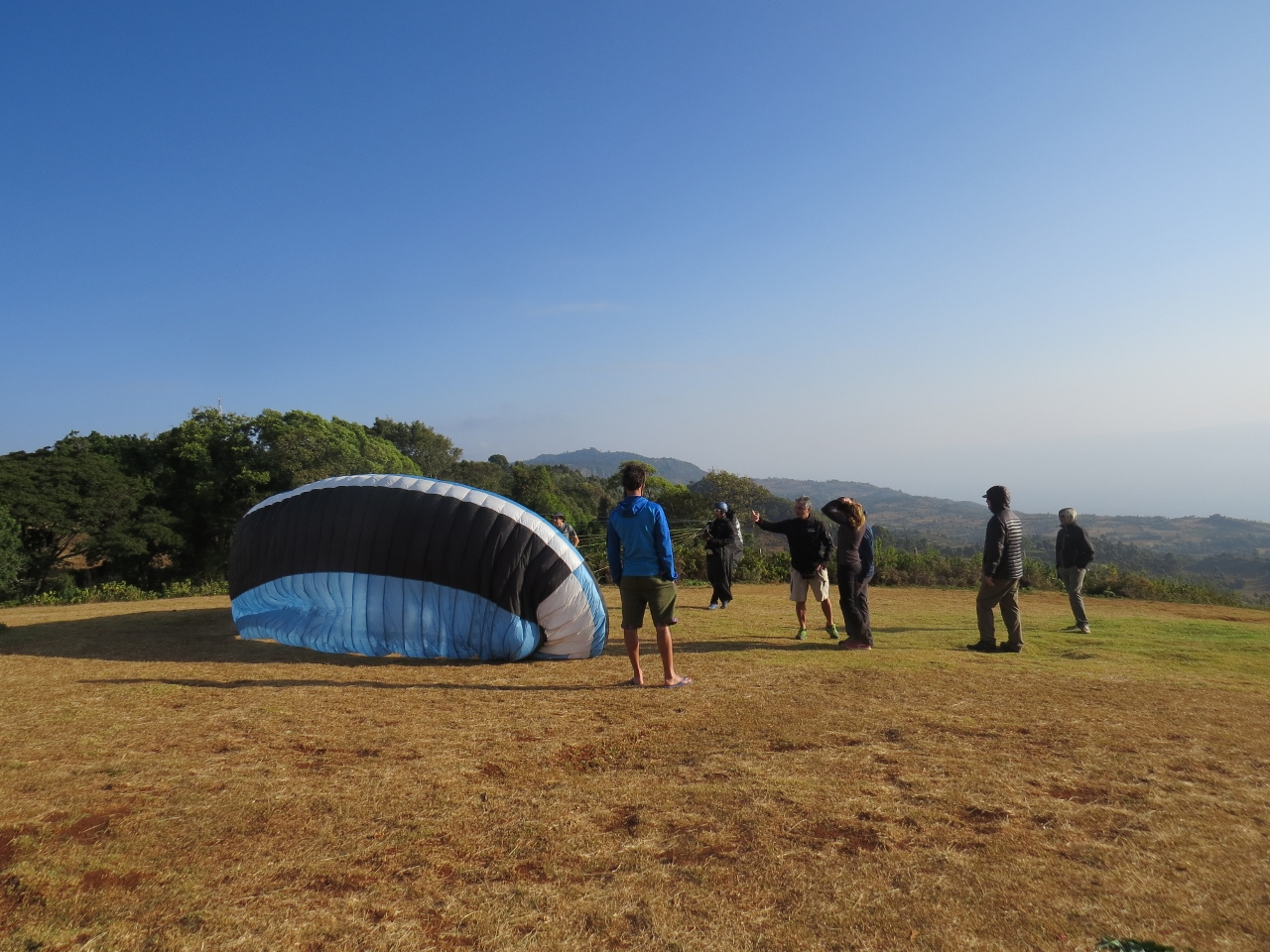 Paragliders on Elgeyo Marakwet escarpment getting ready to take off. Copyright Rupi Mangat