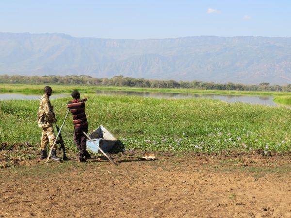 Lake Kamnarok with Elgeyo Marakwet range. Notie water hyacinth the weed choking the lake. Copyright Rupi Mangat