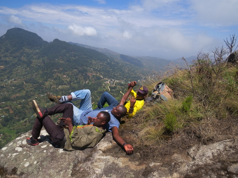 On the peak of Iyale overlooking Taita -a well deserved break from l to r- Handrison Mwameso, Maina Gichia and Evanson Jardel Wangusha, a guide with Dawida Biodiversity Conservation group (DABICO) copyright Rupi Mangat