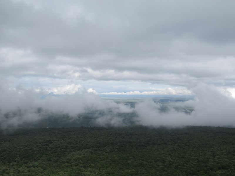 Rain clouds hurtle down the escarpment to fill the deep valley of the Great Rift. Copyright Rupi Mangat