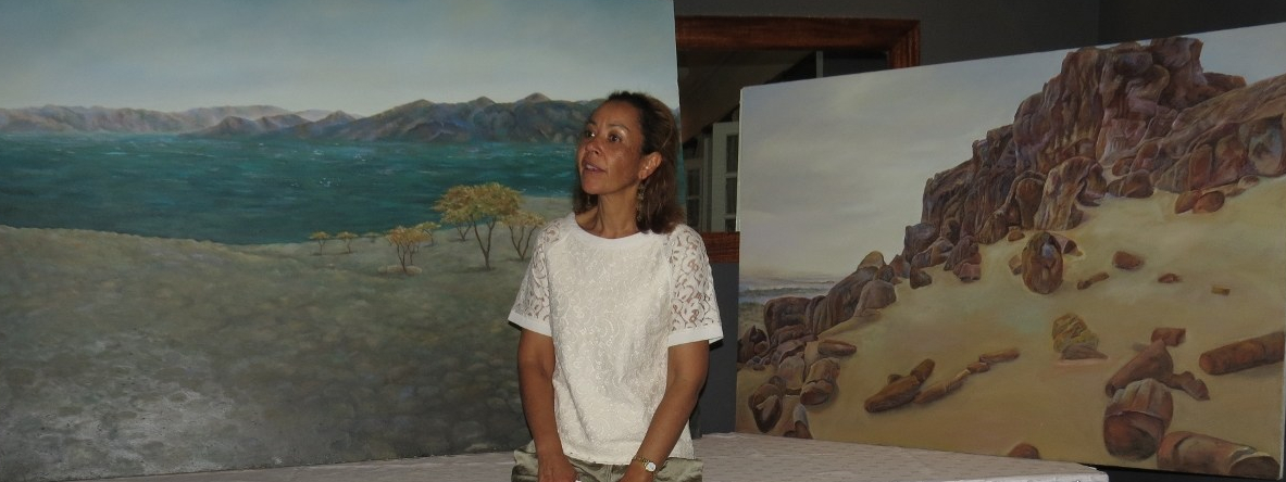 Camille Wekesa at her art exhibition Jade & Silver with the Jade Sea (Lake Turkana) and the shades of the petrified forest by the lake.