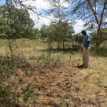 Moses Parmisa showing the rhino midden in Naretunoi Conservancy, Kitengela by Nairobi National Park Copyright Rupi Mangat