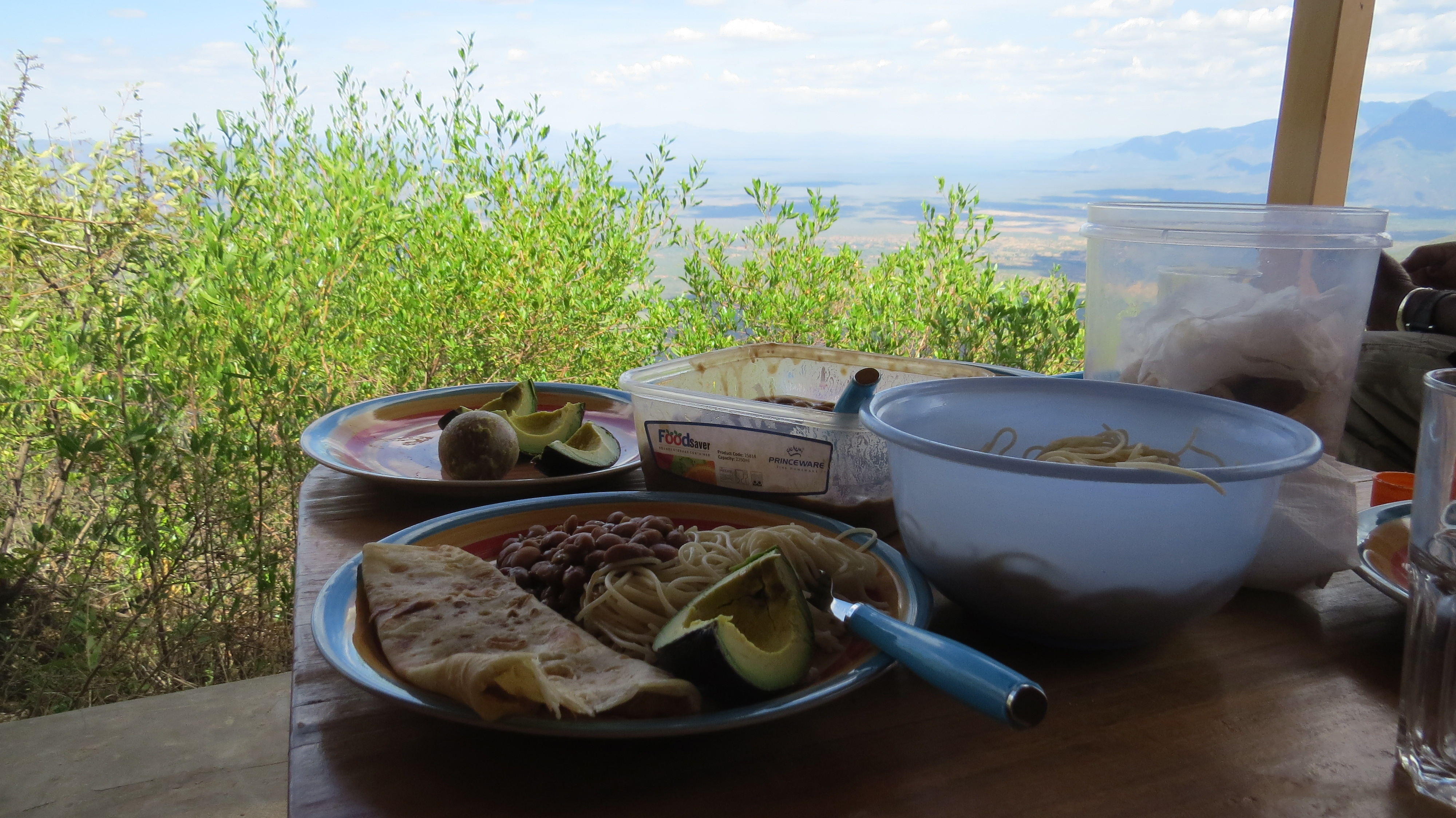 Lunch on porch of Mountain cabin in Sekerr Range.Copyright Rupi Mangat