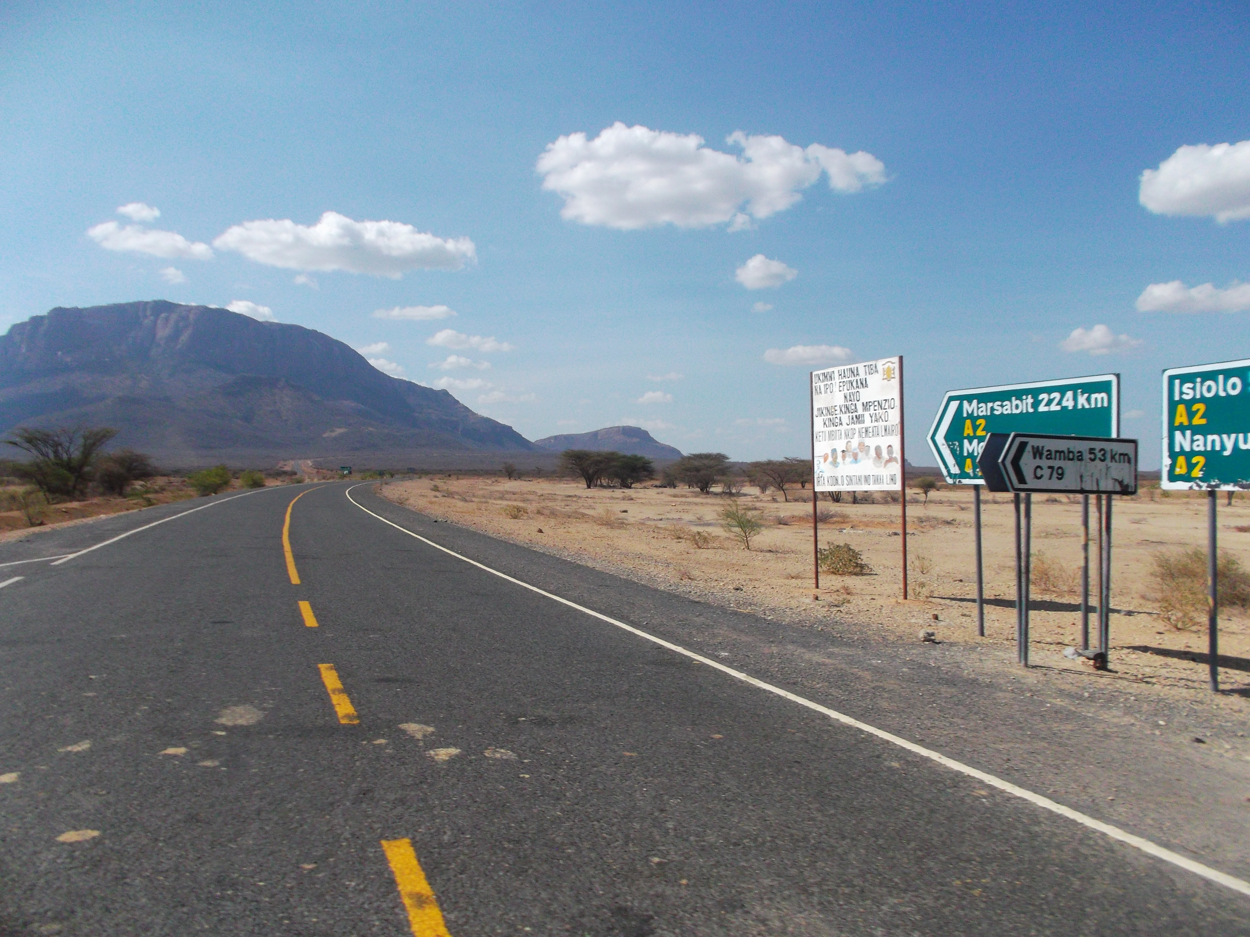 The new tarnac road to the north past Samburu and the Mt Lolokowe - the bread-shaped iconic mt of the north.