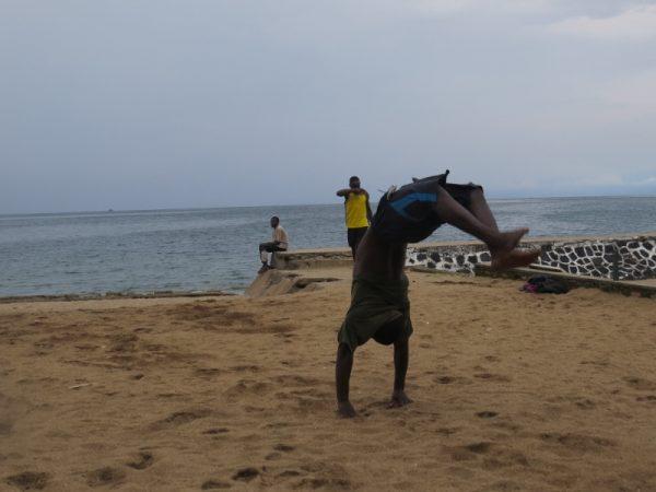 Boy practising acrobatics by Lake Kivu in Gisenyi, Rwanda. Copyright Rupi Mangat (800x600)
