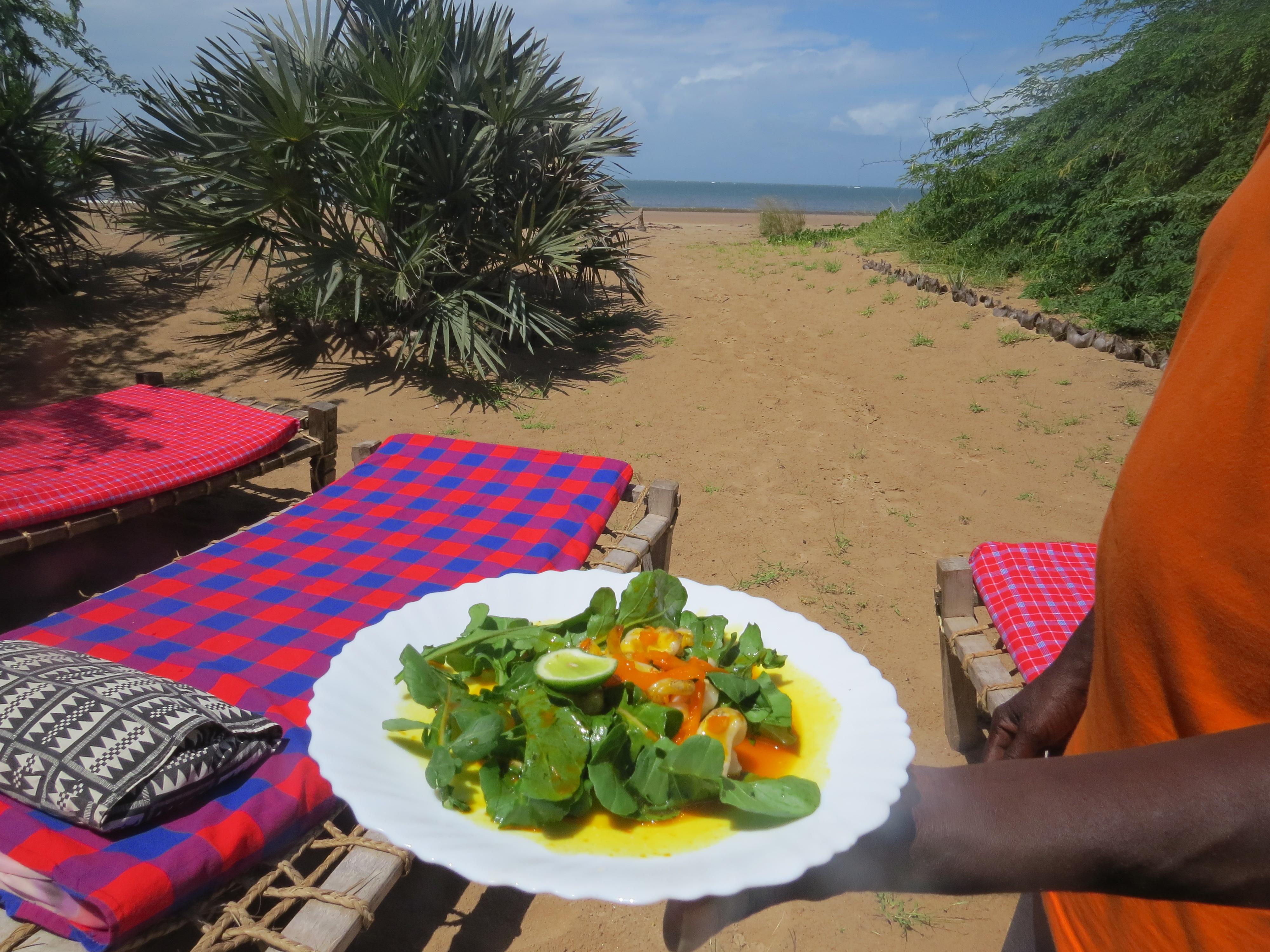 Calamari in orange saucewith a tinge of saffron at Barefoot Beach Camp in Malindi. Copyright Rupi Mangat