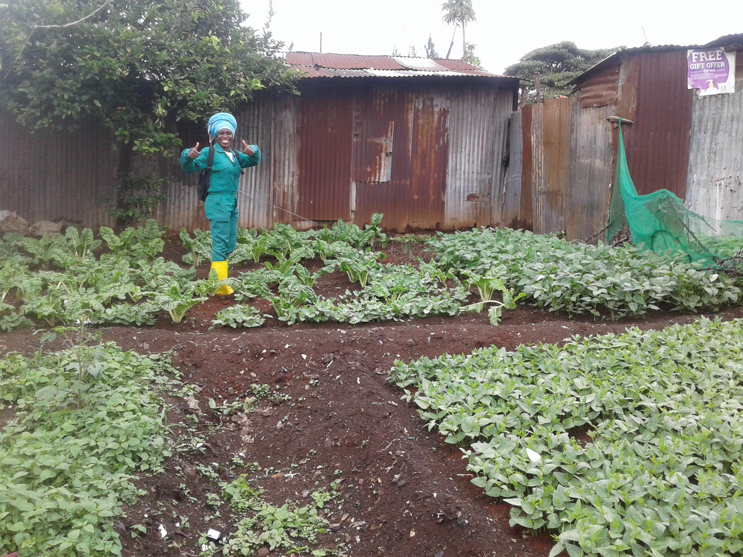 Debora Ogollah in the vegetable polt to feed the kids in Korogocho slum, Nairobi. Copyright Rupi Mangat