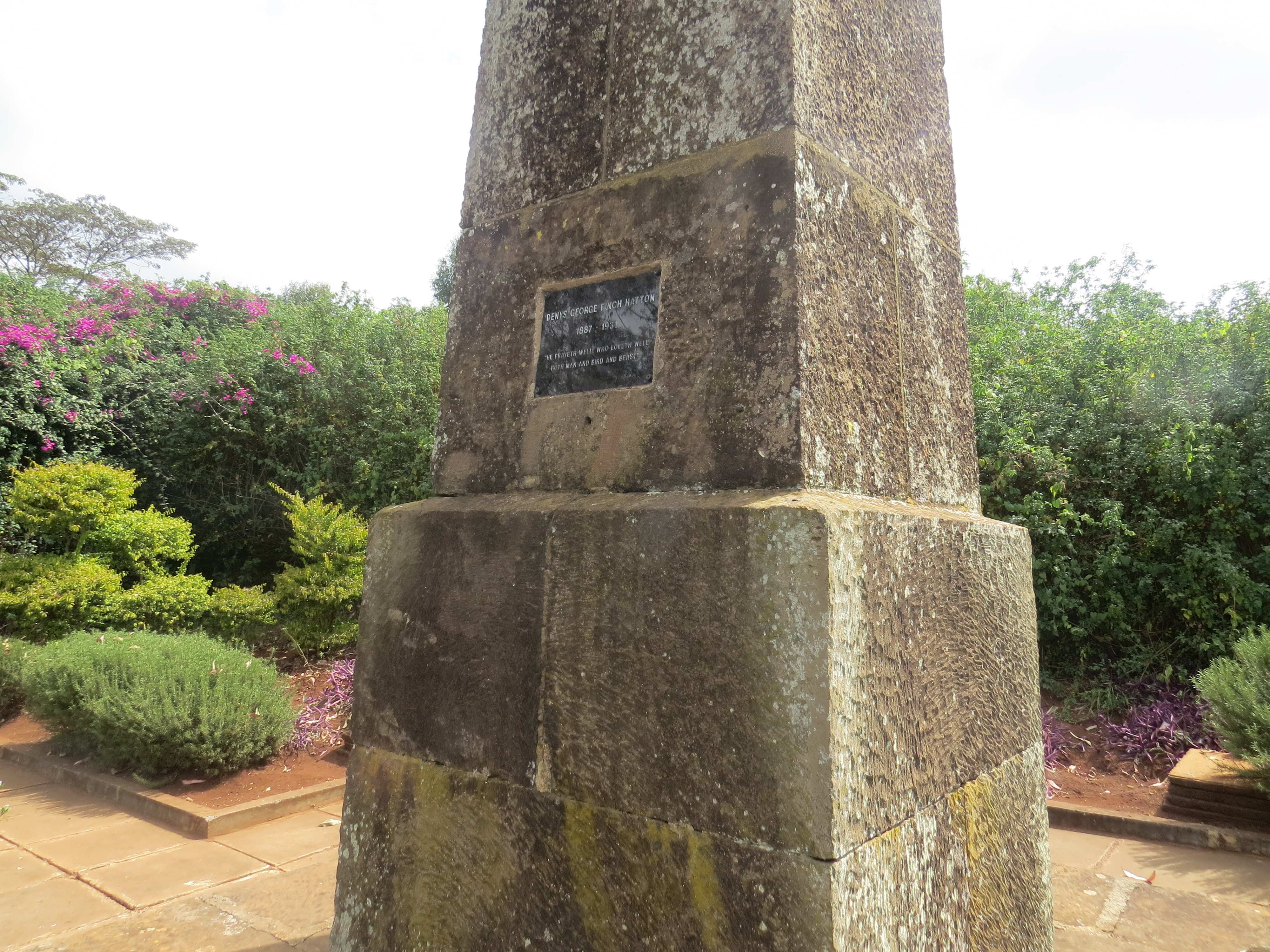 Part of the obelix with the plaque on Ngong Hills for Denys Finch Hatton reads 'He prayeth well, who loveth well both man and bird and beast'. . Copyright Rupi Mangat