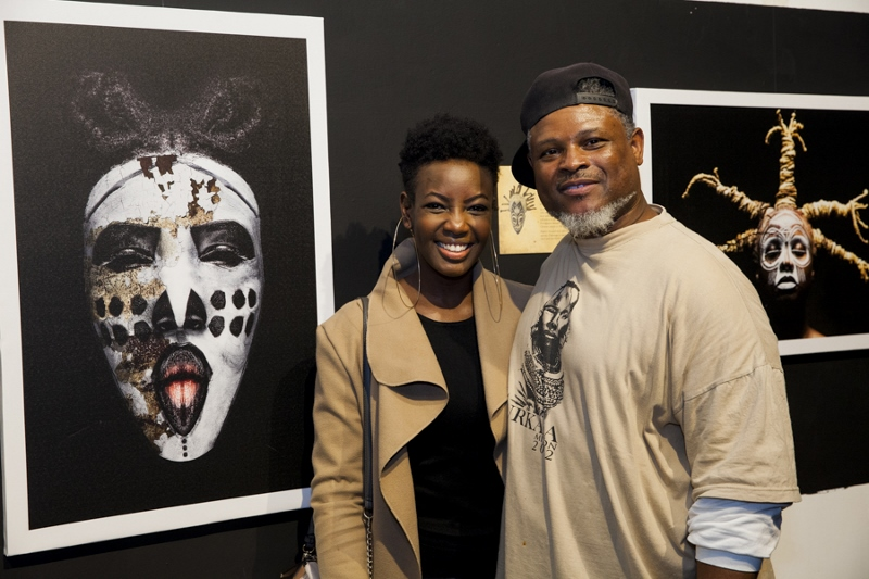 Teddy Mitchener with Mumbi Maina and his picture of her mask. Copyright Teddy Mitchener (800x533)